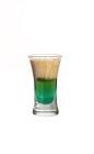 The Irish Flag Shot is made from Mandarine Napoleon, creme de menthe and Baileys Irish Cream, and served in a shot glass.